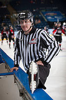 KELOWNA, CANADA - NOVEMBER 8: Ward Pateman, linesman, stretches on the ice at the Kelowna Rockets on November 8, 2013 at Prospera Place in Kelowna, British Columbia, Canada.   (Photo by Marissa Baecker/Getty Images)  *** Local Caption ***