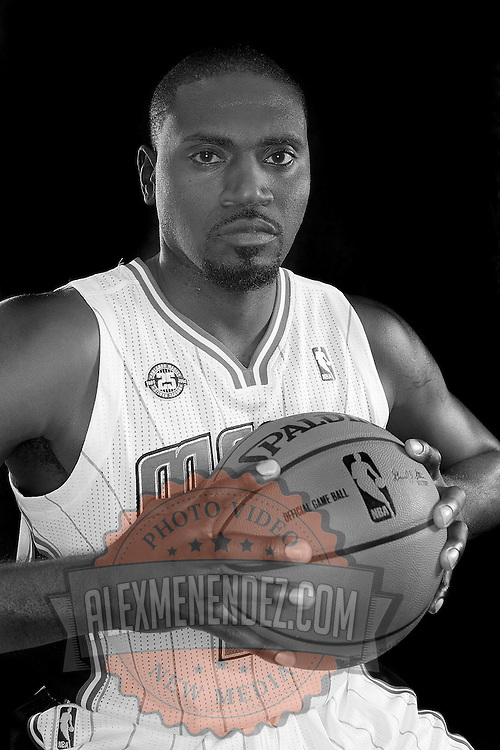 Jason Maxiell poses in front of a backdrop during the Orlando Magic media day event at the Amway Arena on Monday, September 30, 2103 in Orlando, Florida. (AP Photo/Alex Menendez)