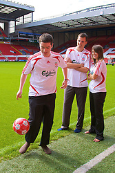 LIVERPOOL, ENGLAND - Thursday, September 6, 2007: Liverpool FC.TV presenters Peter McDowall juggles the ball whilst fellow presenters Matt Critchley and Claire Rourke look on at Anfield. (Photo by David Rawcliffe/Propaganda)
