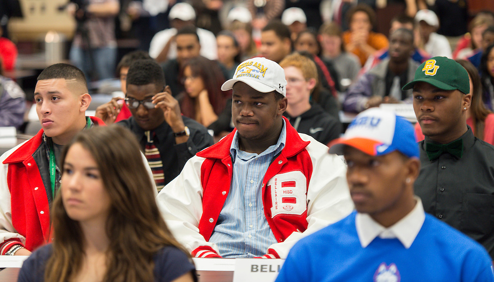Students listen to comments during a National Signing Day ceremony at the Region 4 Education Center, February 5, 2014.