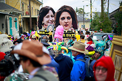 17 Feb 2015. New Orleans, Louisiana.<br /> Fat Tuesday. Mardi Gras Day. Faces in the crowd. Revelers dressed in costume for the day parade giant placards of Rita Benson Leblanc, Gayle and Tom Benson parodying the billionaire family fight for control of the Saints, Pelicans and other business interests.<br /> Photo; Charlie Varley/varleypix.com
