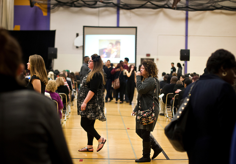 Mourners walk to their seats at the funeral for Tony Robinson, Jr. at Madison East High School in Madison, Wisconsin, Saturday, March 14, 2015. Hundreds of people gathered on Saturday for the funeral of a 19-year-old man killed by a police officer in Wisconsin's capital on March 6, a shooting that prompted protests over law enforcement's treatment of minorities.  REUTERS/Ben Brewer (UNITED STATES)