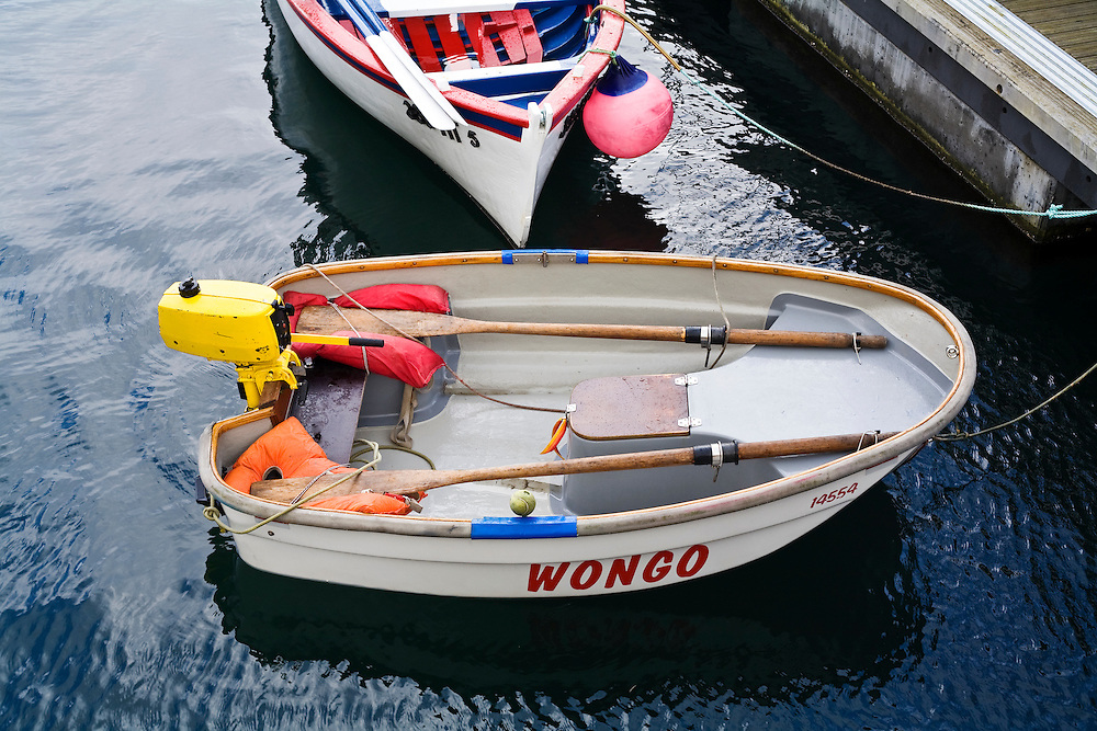 A dinghy called Wongo on the dock in the Azores. .A dinghy with a strange name at the dock. Horta is on the island of Faial. One of of the Azores, which is  a group of islands in the Atlantic that are a part of Portugal and the European Union. Horta is a popular stop for yachts crossing the Atlantic in the Spring time to return to Europe.