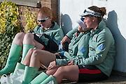 London, Great Britain, CUWBC crew members, relax in the sun, despondent, after losing the Newton Women's Boat Race. The Newton Women's Boat race and the reserve races Mortlake. ENGLAND. <br /> <br /> CUWBC Crew: Fanny BELAIS, Ashton BROWN, Caroline REID, Clare WATKINS, Melissa WILSON, Holly HILL, Daphne MARTSCHENKO,Hannah EVANS, Cox Rosemary OSTFELD<br /> <br /> 17:45:21  Saturday  11/04/2015<br /> <br /> [Mandatory Credit; Intersport-images]