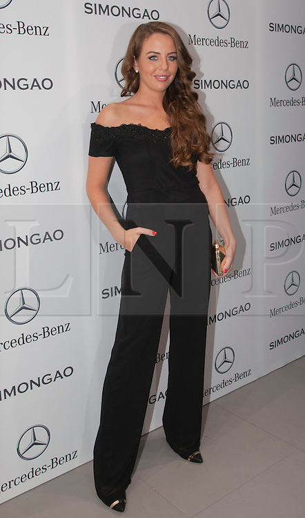 © Licensed to London News Pictures. 18 February 2014, London, England, UK. Pictured: Lydia Bright. Celebrities attend the Mercedes-Benz sponsored SIMONGAO show during London Fashion Week AW14 at the BFC Courtyard Show Space/Somerset House. Photo credit: Bettina Strenske/LNP