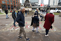 """© Licensed to London News Pictures. 07/04/2018. Manchester, UK. A mural that reads """" We Love Mcr , from Canada with love """" by Toronto artist Victor Fraser , in Piccadilly Gardens in Manchester City Centre , has been renewed with fresh paint , nearly a year after it was first drawn , in response to the terrorist attack at an Ariana Grande concert at Manchester Arena . Photo credit: Joel Goodman/LNP"""