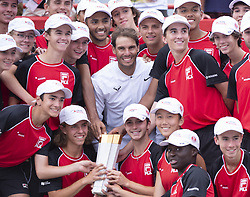 Rafael Nadal, of Spain, poses for a photo with the ball retrievers after beating Daniil Medvedev, of Russia, in the final at the Rogers Cup tennis tournament, in Montreal on Sunday, Aug. 11, 2019. Photo by Paul Chiasson/CP/ABACAPRESS.COM