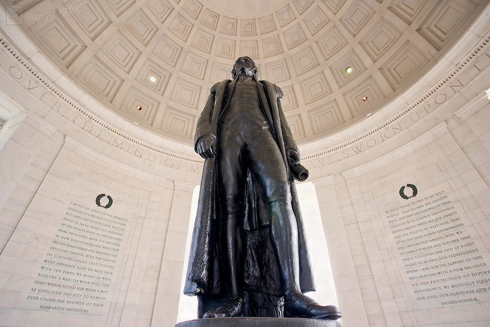 A wide angled view looking up the bronze statue of Thomas Jefferson in the Jefferson Memorial in Washington, D.C. The statue was commissioned to Rudolph Evans in 1941. The bronze statue, standing 19 feet tall and weighing five tons, replaced the original plaster statue when the restriction on the use of metals was lifted after World War 2.