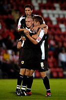 Photo: Ed Godden.<br /> Cheltenham Town v Bristol City. Carling Cup. 22/08/2006.<br /> David Cotterill (L) is congratulated by his Bristol team mates after scoring.