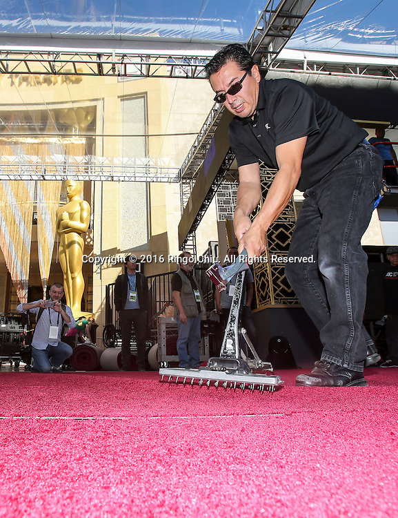 A worker stretches out the red carpet for the Oscars in front of the Dolby Theatre in Los Angeles, Wednesday, February 24, 2016. The 88th Academy Awards will be held Sunday, February 28, 2016. (Photo by Ringo Chiu/PHOTOFORMULA.com)<br /> <br /> Usage Notes: This content is intended for editorial use only. For other uses, additional clearances may be required.