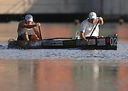 Second place finishers Ryan and Rodney Halstead of Grayling, MI try to close the gap on the race leaders as they paddle away from the Five Channels Dam.