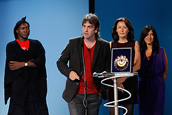"""24.09.2011, Sebastian Donostia, ESP, 59. San Sebsatian Filmfestival, Zinemaldia, im Bild Spanish director Isaki Lacuesta (f) poses with actor  Amassagou Dolo (l), writer Isa Campo (r) and Producer Luisa matienzo (2r) Golden Shell for the Best Fil for """"Los Pasos Dobles"""" during the 59th San Sebastian Donostia International Film Festival - Zinemaldia.September 24,2011.EXPA Pictures © 2011, PhotoCredit: EXPA/ Alterphoto/ Acero +++++ ATTENTION - OUT OF SPAIN/(ESP) +++++"""