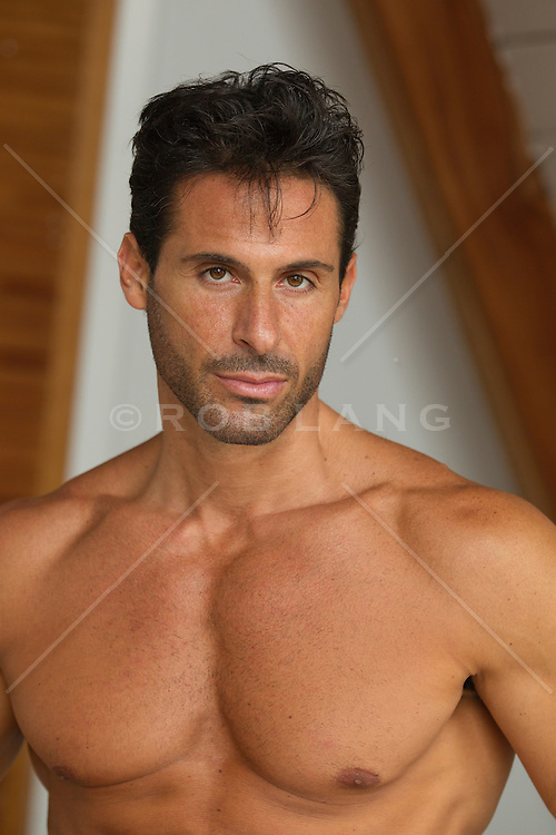 portrait of a handsome man with brown hair and brown eyes without a shirt