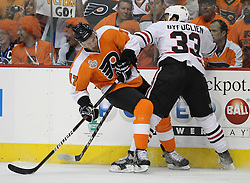 June 9, 2010; Philiadelphia, PA; USA;  Philadelphia Flyers center Jeff Carter (17) is hit by Chicago Blackhawks right wing Dustin Byfuglien (33) during the first period of Game 6 of the Stanley Cup Finals at the Wachovia Center.