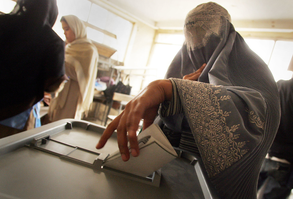 09 October 2004&amp;#xD;&amp;#xA;Kabul, Afghanistan.&amp;#xD;&amp;#xA;Presidential elections in Afghanistan.&amp;#xD;&amp;#xA;&amp;#xD;&amp;#xA;Afghanistans historic Presidential elections saw both men and women heading to the polling stations. Many of the women were wearing traditional burka's. They had to lift the veils in order to have their identity checked before proceeding with their vote. Both men and women had their thumbnails painted to avoid repetitious voting. Reports circulated that the ink had not proved to be indelible and that voters were simply rubbing it off.&amp;#xD;&amp;#xA;&amp;#xD;&amp;#xA;By mid afternoon 15 candidates had pulled out of the running amidst allegations of fraud.<br />