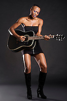 African American woman playing guitar