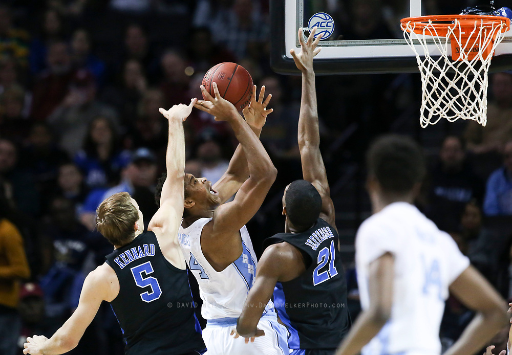 North Carolina forward Isaiah Hicks (4) attempts to lay in the ball while being pressured by Duke guard Luke Kennard (5) and Duke forward Amile Jefferson (21) during the semifinals of the 2017 New York Life ACC Tournament at the Barclays Center in Brooklyn, N.Y., Friday, March 10, 2017. (Photo by David Welker, theACC.com)