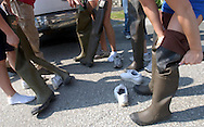 The group all puts on waders before entering into the stream to collect samples of river life.