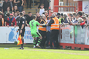 Lee Collins scuffles with stewards as they try to eject a pitch invader during the EFL Sky Bet League 2 match between Cheltenham Town and Forest Green Rovers at LCI Rail Stadium, Cheltenham, England on 14 April 2018. Picture by Antony Thompson.