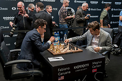 © Licensed to London News Pictures. 26/11/2018. LONDON, UK.  London, UK.  26 November 2018.  Magnus Carlsen (R) of Norway competes against Fabiano Caruana (L) of the United States in the 12th game of the World Chess Championship taking place at The College in Holborn.  The 12 game match is currently tied after 11 draws.  Photo credit: Stephen Chung/LNP