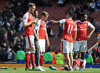 Football - 2016 / 2017 Premier League - Arsenal vs. Everton<br /> <br /> A dejected Mesut Ozil and Per Mertesacker of Arsenal after failing to qualify for the Champions League after the match at The Emirates.<br /> <br /> COLORSPORT/ANDREW COWIE