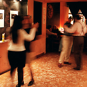 ANGELA JIMENEZ-FUL 105 May 22, 1999<br />Heterosexual couples break into same sex pairs to learn tango steps at a tango cafe in Buenos Aires.  The tango is Argentina's traditional dance and music.  Men and women have distinct roles in the dance, with men leading the steps.  La Fulana is trying to organize a tango class for lesbians.