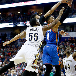 Jan 25, 2017; New Orleans, LA, USA; Oklahoma City Thunder guard Russell Westbrook (0) shoots over New Orleans Pelicans guard E'Twaun Moore (55) and forward Anthony Davis (23) during the second quarter of a game at the Smoothie King Center. Mandatory Credit: Derick E. Hingle-USA TODAY Sports