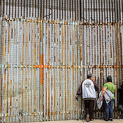 "Every Sundays, deported Mexicans meet with their relatives on the other side of the border through the infamous ""wall"". American border guards open the internal gates of the International Frienship park for 4 hours to allow relatives who are on the American side of the border to see and speak to each others. They can't touch each others though, but at least for those 4 hours they will feel closer"