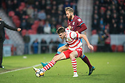 Doncaster Rovers Midfielder Ben Whiteman (12) battles with Scunthorpe United striker Kevin Van Veen (10) during the The FA Cup match between Doncaster Rovers and Scunthorpe United at the Keepmoat Stadium, Doncaster, England on 3 December 2017. Photo by Craig Zadoroznyj.