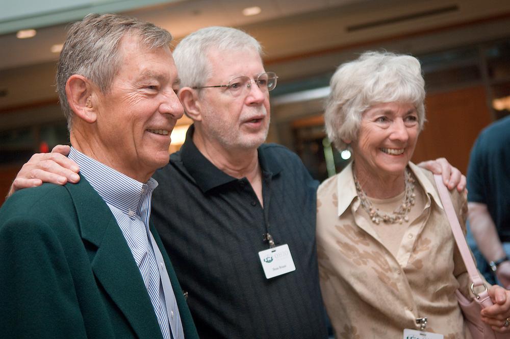 18660Golden Reunion, class of 1958: Tour of Baker Center..Senator George Voinovich & Mrs. Voinovich greets take picture with Dean Braun