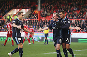 Gary Irvine is congratulated by Luka Tankulic and Greg Stewart after scoring Dundee's equaliser -  Aberdeen v Dundee, SPFL Premiership at Pittodrie<br />
