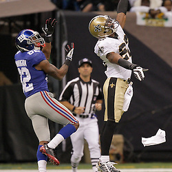 2009 October 18: New Orleans Saints cornerback Tracy Porter (22) knocks down a pass intended for New York Giants wide receiver Mario Manningham (82) during the first quarter at the Louisiana Superdome in New Orleans, Louisiana.