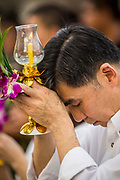 "25 FEBRUARY 2013 - BANGKOK, THAILAND:  A man prays at Wat Benchamabophit Dusitvanaram (popularly known as either Wat Bencha or the Marble Temple) on Makha Bucha Day. Makha Bucha is a Buddhist holiday celebrated in Myanmar (Burma), Thailand, Cambodia and Laos on the full moon day of the third lunar month (February 25 in 2013). The third lunar month is known in Thai is Makha. Bucha is a Thai word meaning ""to venerate"" or ""to honor"". Makha Bucha Day is for the veneration of Buddha and his teachings on the full moon day of the third lunar month. Makha Bucha Day marks the day that 1,250 Arahata spontaneously came to see the Buddha. The Buddha in turn laid down the principles his teachings. In Thailand, this teaching has been dubbed the 'Heart of Buddhism'.     PHOTO BY JACK KURTZ"