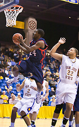 November 30, 2009; San Jose, CA, USA;  Saint Mary's Gaels guard Wayne Hunter (24) shoots past San Jose State Spartans forward C.J. Webster (22) during the first half at the Event Center Arena.  Saint Mary's defeated San Jose State 78-71.