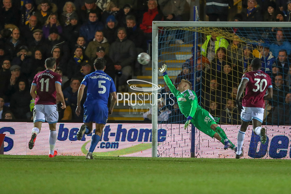 AFC Wimbledon goalkeeper Aaron Ramsdale (35) was not able to save a free kicj from West Ham United attacker Felipe Anderson (8) during the The FA Cup match between AFC Wimbledon and West Ham United at the Cherry Red Records Stadium, Kingston, England on 26 January 2019.