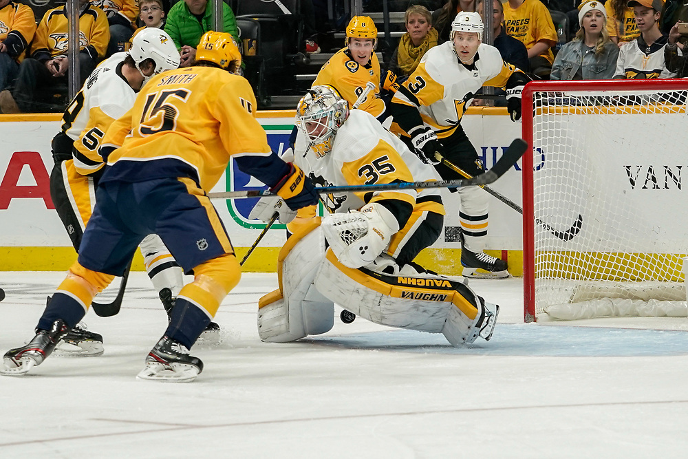 Nashville Predators right wing Craig Smith (15) scores on Pittsburgh Penguins goaltender Tristan Jarry (35) during a game between the Pittsburgh Penguins and Nashville Predators at Bridgestone Arena in Nashville, TN December 27, 2019