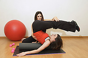 A female physiotherapist instructor training another woman during a session - MR