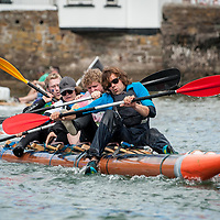 REPRO FREE<br /> The raft from the Kinsale Outdoor Education Centre capsizing at the start of the RNLI Raft Race in Kinsale on Saturday of the Bank Holiday Weekend. They were all rescued seconds later and went on to finish second..<br /> Picture. John Allen