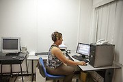 Systems attendant Denia Ochoa uses a vaccine stock management system at the PAI (Programa Ampliado de Inmunizaciones) offices in Tegucigalpa, Honduras, on Wednesday April 24, 2013..