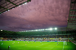 SWANSEA, WALES - Saturday, September 28, 2013: Swansea City take on Arsenal under a purple sky during the Premiership match at the Liberty Stadium. (Pic by David Rawcliffe/Propaganda)