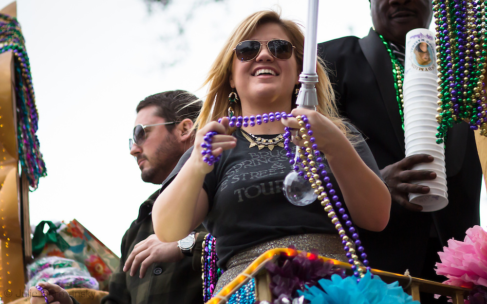 """New Orleans, LA, February 9, Kelly Clarkson, grandmarshal of Krewe Of  2013 Endymion <br /> Parade rides on the Endymion Mardi Gras float wearing an engagement ring next to fiancé Brandon Blackstock. The Krewe of Endymion rolls through Mid-Cityon the traditional route during the parades 47th year with the theme """"Ancient Mysteries""""."""