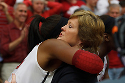 Dec 20, 2011; Stanford CA, USA;  Stanford Cardinal forward Nnemkadi Ogwumike (30) hugs Tennessee Lady Volunteers head coach Pat Summitt (right) after the game at Maples Pavilion.  Stanford defeated Tennessee 97-80. Mandatory Credit: Jason O. Watson-US PRESSWIRE