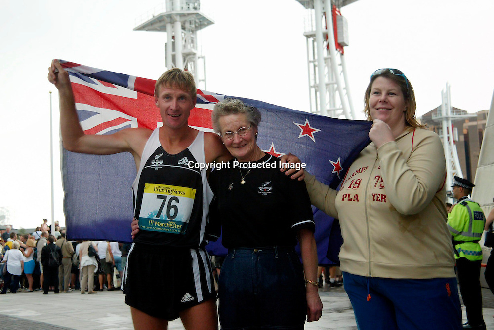 24 July 2002, Commonwealth Games, Men's 50km Walk-Final, Manchester, England.<br />Craig Barrett of New Zealand with his Mother and Sister after he finished second to take the silver medal.<br />Pic: Sandra Teddy/Photosort