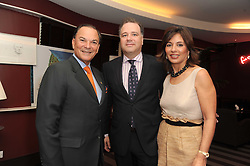 A party to promote the exclusive Puntacana Resort & Club - the Caribbean's Premier Golf & Beach Resort Destination, was held at The Groucho Club, 45 Dean Street London on 12th May 2010.<br /> <br /> Picture shows:-Left to right, FRANK RAINIERI, ? and MRS FRANK RAINIERI