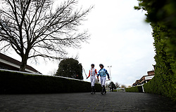 General view of jockey's Robert Havlin and John Egan walking into the parade ring before the Matchbook Betting Podcast Rosebery Handicap during the Easter Family Fun Day at Kempton Park Racecourse. PRESS ASSOCIATION Photo. Picture date: Saturday March 31, 2018. See PA story RACING Kempton. Photo credit should read: Steven Paston/PA Wire