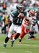 Philadelphia Eagles quarterback Carson Wentz (11) rolls to his right while looking to pass despite defensive pressure from Cleveland Browns defensive lineman Danny Shelton (55) during the 2016 NFL week 1 regular season football game against the Cleveland Browns on Sunday, Sept. 11, 2016 in Philadelphia. The Eagles won the game 29-10. (©Paul Anthony Spinelli)