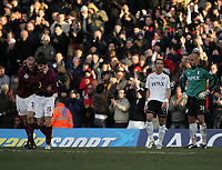 Photo: Lee Earle.<br /> Fulham v Arsenal. The Barclays Premiership. 04/03/2006. Arsenal's Phillippe Senderos (L) congratulates Francesc Fabregas after he scored their fourth. Fulham's Liam Rosenior (2ndR) and keeper Tony Warner can just watch.