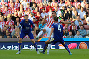 Stoke City's Jonathan Walters keeps his eyes on the ball during the Barclays Premier League match between Stoke City and Leicester City at the Britannia Stadium, Stoke-on-Trent, England on 19 September 2015. Photo by Aaron Lupton.