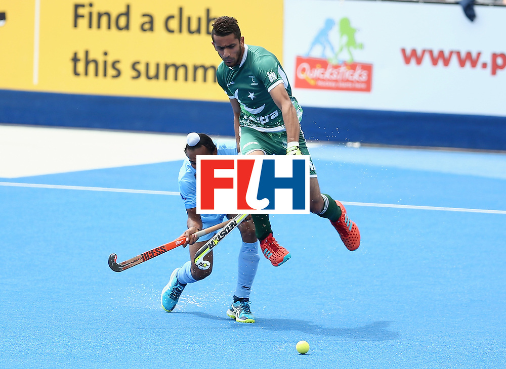 LONDON, ENGLAND - JUNE 24: Sardar Singh of India and Ammad Shakeel of Pakistan battle for possession  during the 5th-8th place match between Pakistan and India on day eight of the Hero Hockey World League Semi-Final at Lee Valley Hockey and Tennis Centre on June 24, 2017 in London, England. (Photo by Steve Bardens/Getty Images)