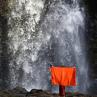 Young Monk dresses below Bousra Waterfall in Sen Monorom, Mondulkiri province, Cambodia